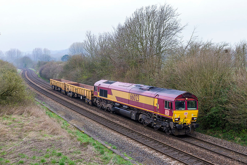28th Mar 2017:  66023 is working 6O41 the morning departmental from Westbury to Eastleigh through Sherrington on a slightly misty morning.  A waste of time really