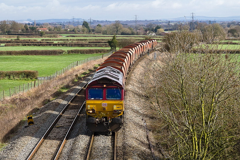 8th Mar 2017:  Nearing Pot Lane in Berkley is 66127 with the old RMC hoppers in tow.  6V33 is the 07.20 from Wembley Eurofreight Terminal to Whatley Quarry