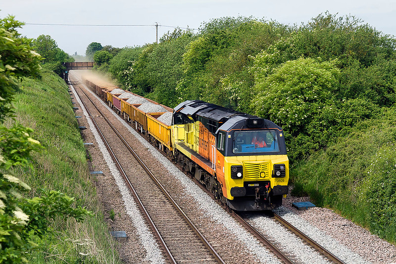 28th May 2017:  Taken from Lambourn Lane in Edington 70809 is working 6C26 from Westbury to Faxhall Junction in Didcot.  I wionder how nm,uch sand will have been blown/sucked  out when it gets there ?