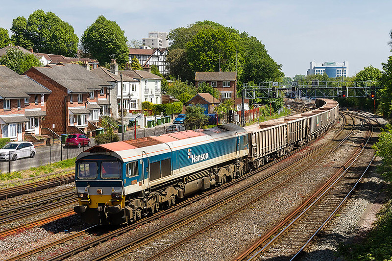 10th May 2017:  With Saxon Road as a backdrop 59101 runs through Southampton with the stone empties from Chichester to Mereheady (7V07)