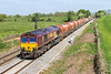8th May 2017:  In welcome sunlight but still with a strong cold wind blowing 66181 in charge of 6V98 from WEmbley Eurofreight Operations Centre to Whatley quarry nears Fairwood Junction.  The rusty looking RMC hoppers make a pleasant change from the usual waggons