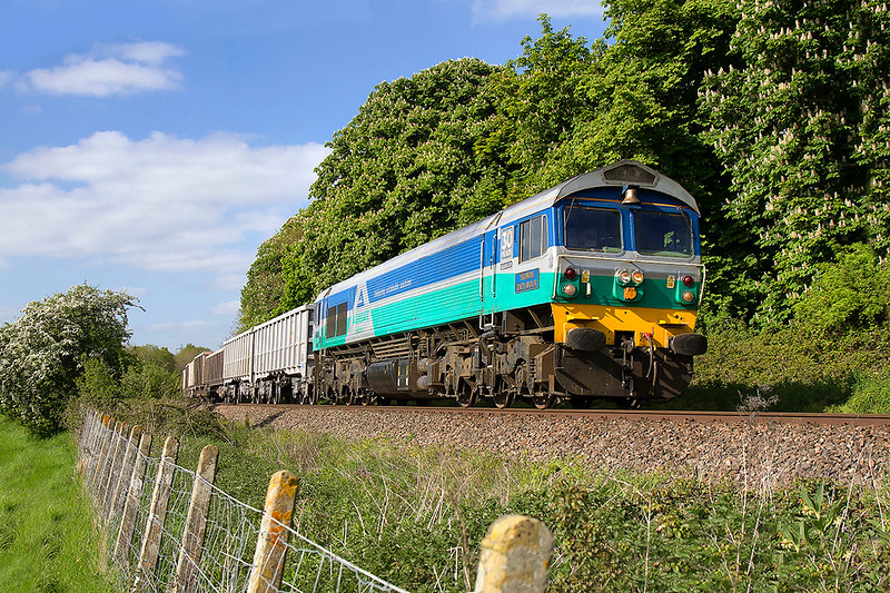 9th May 2017:  Running over 30 minutes early is 59001 hauling 6C48 the empties from Appleford to Whatley is pictured as it nears Melksham.  The floaterc clould melted away as the train hove into view