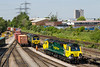10th May 2017:  Pictured from the road bridge at Maritime are 66592 and 70005 both recently arrived from the north.  The latter on 4O18 from Lawley Street.  The shunter is  walking  back having changed the point to allow the containers to be shunted to the other road