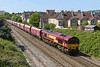 9th May 2017:  Tundling east though Oldfield Park is 66109 at the helm of 6Z83 from Avonmouth Bennets Siding to Westbury.  It is just a shame that the waggons are noy carrying their intended probuct COAL