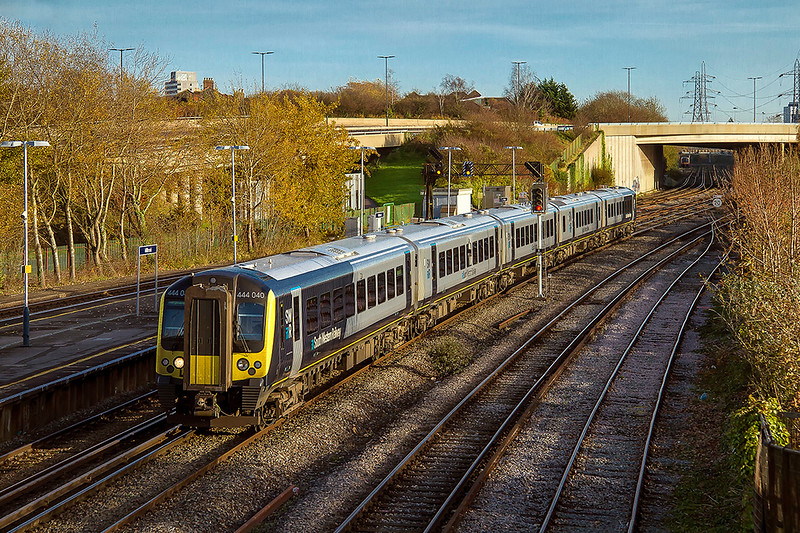 17th Nov 2017:  The first South Western Railway class 444 to be repainted into the new company scheme is 444040.  It is pictured here as it runs through Millbrook while working 1W67 the 13.05 Waterloo to Weymouth.