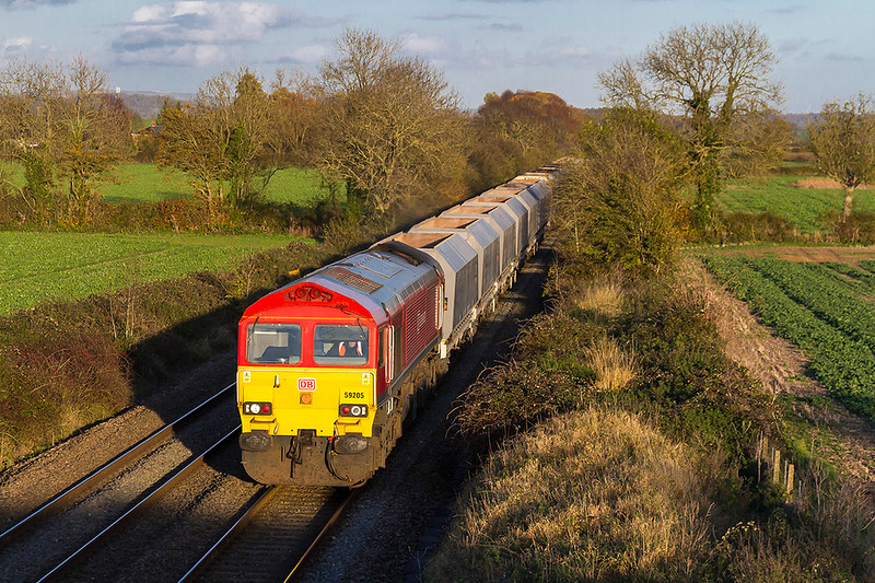 6th Nov 2017:  Pottering down the Berks & Hants through Edington near Westbury is 59205 working 6V18 from Allington to Whatley Quarry.