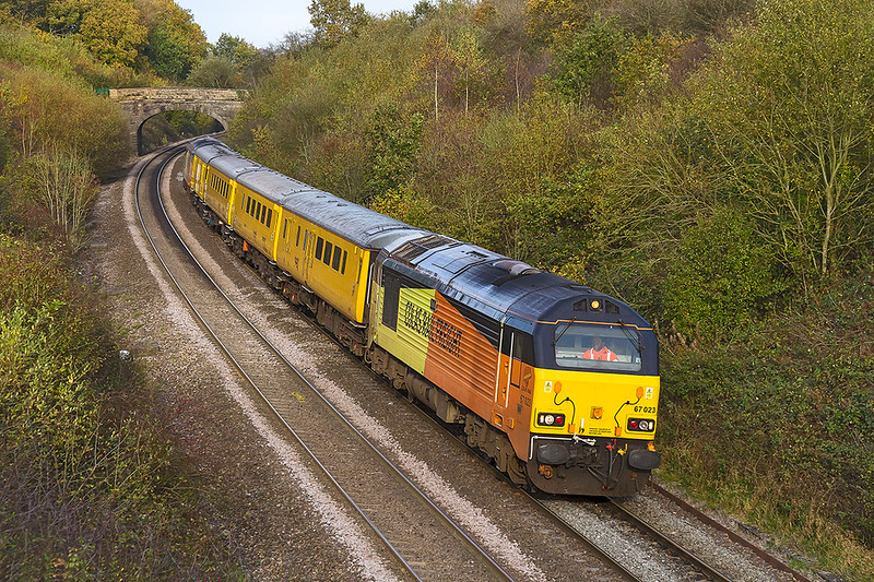 1st Nov 2017.  The days 'tester' from Tyseley to Bristol via Weymouth  is powered by the Colas pair 67023 & 67027.  1Z22  is booked to go through Frome station and is pictured as it slows for Clink Road Junction