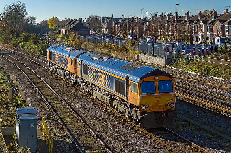 17th Nov 2017:  A pair of especially liveried GBRf 66s make for the station at Eastleigh.  66737. 'Lesia' was named after the MD's wife on her 37th birthday and 66775. 'HMS Argyll; is named after Duke class Frigate F231. HMS Argyll