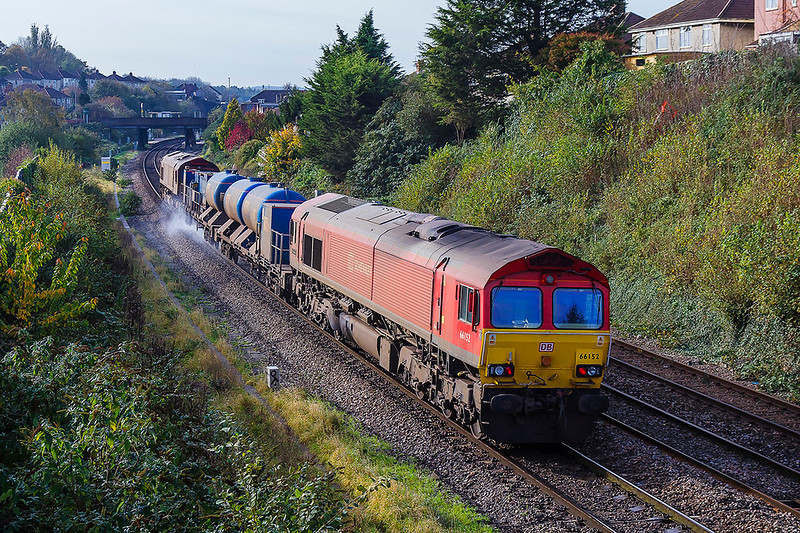 1st Nov 2017:  Almost 15 hours after it left Bristol Bartn Hill to start it's nights work 3S59 is close to the end of the shift.  3S59 with 66152  on the rear and 66024 at the front and are slowing at Parson Street to take the branch to Portbury.  Here they will reverse for the final leg back to Barton Hill