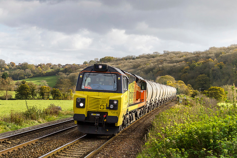 10th Nov 2017:  With only 12 PCAs in tow 70816 runs through Freshford as it works 6C36 the cement empties from Westbury Lafarge to Aberthaw Cement Works