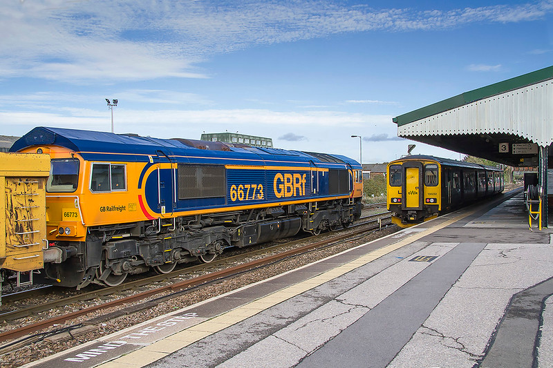 25th Oct 2017:  6M40 to Stud Farm in the hands of 66773 has drawn up to the starter at Westbury to await the road.  It is booked to follow the Westbury to Swindon local.  Standing in Platform 3 is 150232 that is due to form the 12.20 to Swindon.  With a picture of 773 in the bag it just leaves me with 777 to get a picture of the full set.