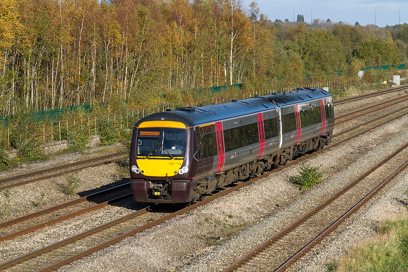 27th Oct 2017:  The Cross Country  service from Nottingham to Cardiff is in the hands of 170114..  Seen at Undy as it passs some reasonably colourful autumnal wood that now grows on the site of one of Severn Tunnel Junction's marshellng yard