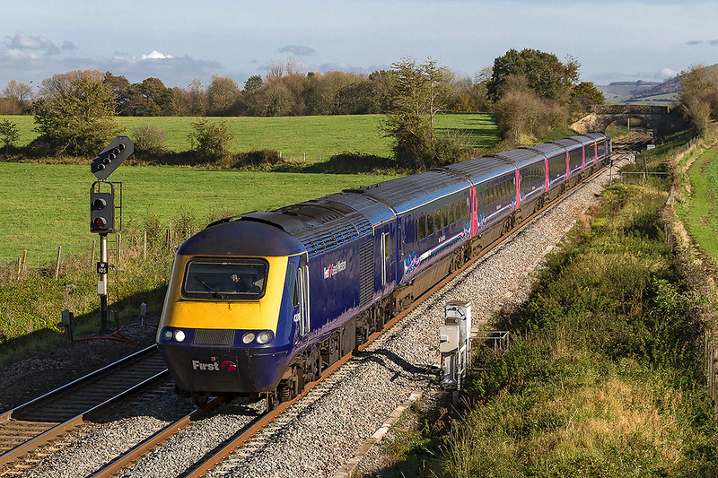 30th Oct 2017:  With the driver giving a friendly wave from 43018 as it works 1C79 the 10.06 from Paddington to Plymouth.  With 43022 0n the back it had started at 10.08, 2 minutes late and had managed to loose another 6 minutes when it got here.  The train looked to be very full.