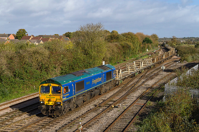 21st Oct 2017:  Arriving at Westbury in a very welcome patch 0f sunlight is 66623 'Bill Bolsover' running as 6Y97 From Filton Abbey Wood to Westbury.  Bringing up the rear of the JZAs is 66557