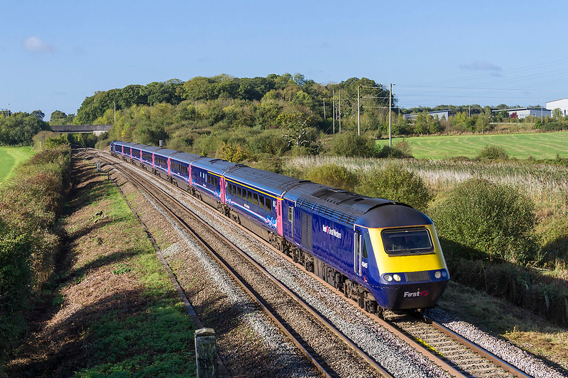 3rd Oct 2017:   43145 is leading on 1A77 the 05.41 from Penzance to Paddington and is pictured at Berkley Marsh near Clink Road Junction in Frome.  The track side on the stretch is being cleared  in advance of the impending use of the diesel powered electrics.  This is in case odd branches damage the pantographs as the trains pass.   It is good that the land has been cleared  but it is a shame that we will have to suffer IEPs