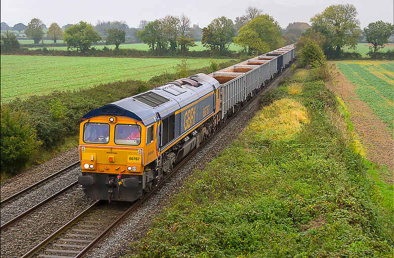 19th Oct 2017:  On a truly horrible day there was a brief spell when the rain ceased that coincided with the passage of the Wellingborough to Whatley empties through Edington.  6V42 is powered by 66767 and is pictured from the bridge on Cowleaze Lane that leads to Baynton Farm