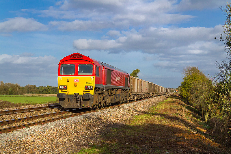 12th Oct 2017:  59204 is in the point of 6V18 from Allington to Whatley Quarry is captured accelerating away from Fairwood Junction