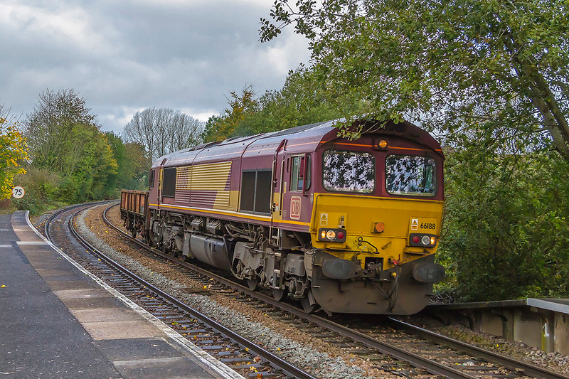 20th oct 2017:  Pottering round the tight v<br /> curve into Warminster station is 66188 tasked with a very lightload on 6O41 the morning departmental to Eastleigh from Westbury.  One day perhaps the  overhanging branches will get cut down though I expect not untill it actually falls onto the lines.