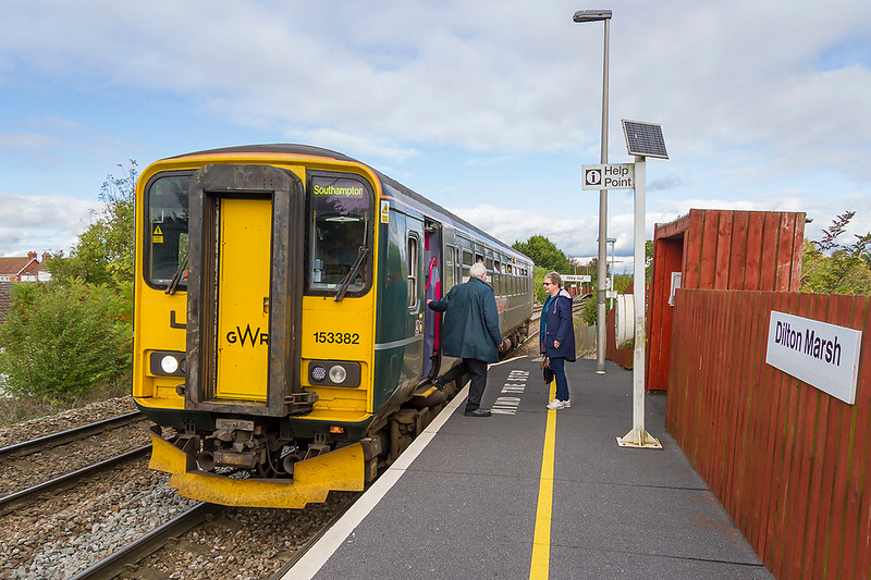 9th October 2017. Working 9O05 the 11.11 from Westbury to Southampton is 153382.  Pictured as it makes i's first stop at Dilton Marsh with the guard extending a wolcome to the only passenger waiting to join the train