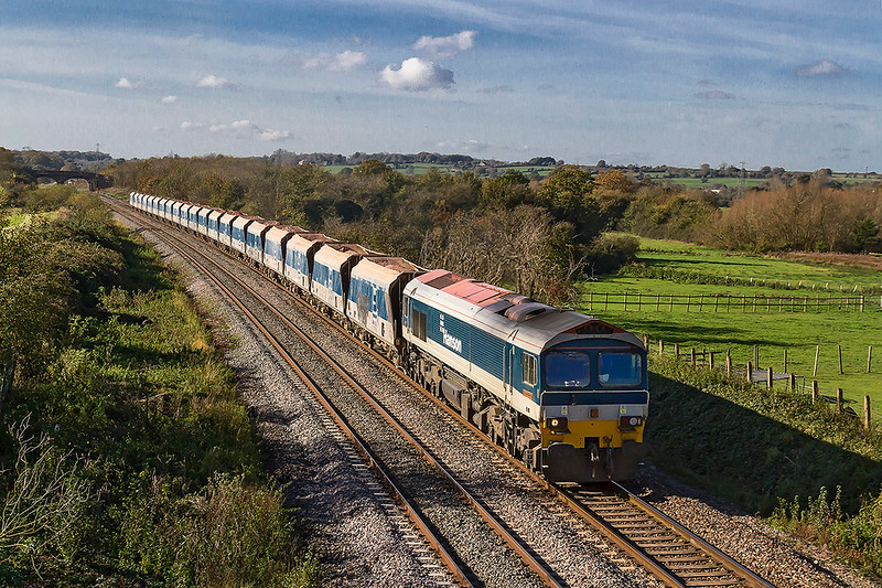 30th Oct 2017.  In perfect Autumnal sunshine 59101 is captured at Fairwood with 6B12 from Merehead to Wootton Bassett.  Fairwood Junction is the other side of the distant bridge.