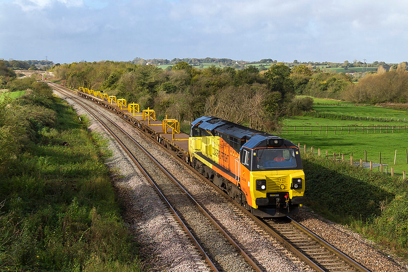 21st Oct 2017: On a very windy day 70812 brings empty rail carriers through Fairwood.  6c20 is working back to Westbury from the work site between Athelney and Castle Cary
