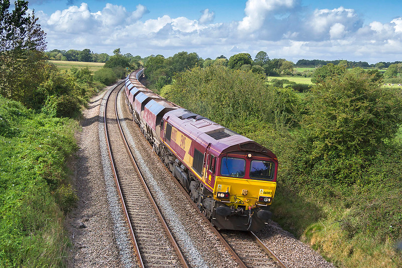12th Sep 2017:  The first production class 66 number 66003 is pictured at Great Cheverell as it heads east with 6M20 to Churchyard Siding at St Pancras from Whatley Quarry.  The consist is ex National Power hoppers