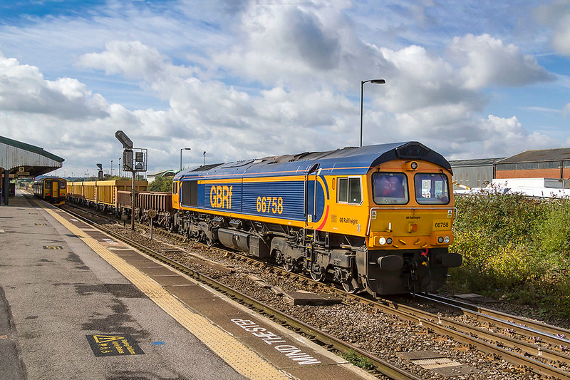 19th Sep 2017:  Just getting underway from Westbury is 66758 powering 6M40 to Stud Farm in Leicestershire where it will get a top up of track ballast for the Westbury Virtual Quarry.  The 2 car class 150 sitting in platform 3 will form the 12.20 to Swindon.