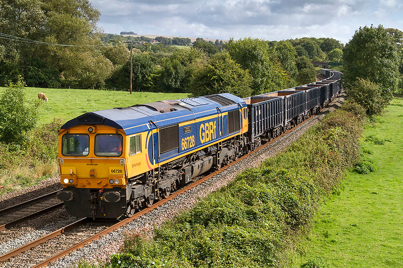 12th Sep 2017: Running a bit late through Great Cheverell is 66728 'Institute of Railway Operators' working 6V42 from Wellingborough to Whatley Quarry for a stone refill.
