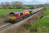 3rd Apr 2018:  Charging down the hill through Great Cheverell is 66060 in charge of 6C58 from Oxford Banbury Road to Whatley Quarry