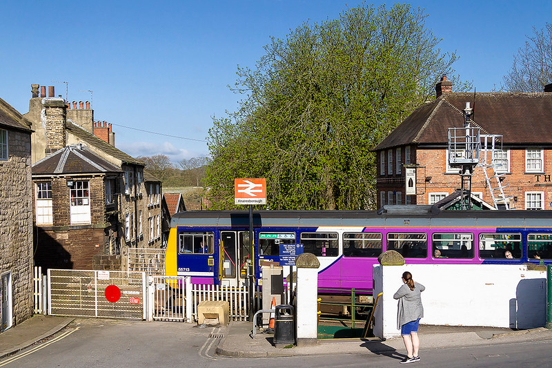 20th Apr 2018:  It is 09.37 and a Class 142 is leaving Knaresborough Station with 2C17 the 09.11 from York to Leeds.  The building on the left with the white windows is the Signal Box. The entry door is out of sight on the left.
