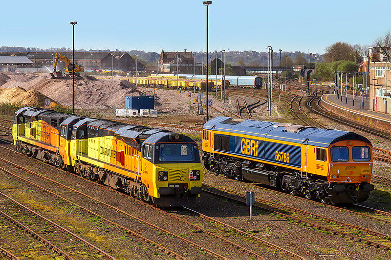 18th Apr 2018:  With the Eastleigh Virtual Qurry in the background Colas pair 70813 & 70803 are standing next to newly repainted GBRf 66786 that was previously owned by DBC and numbered 66141