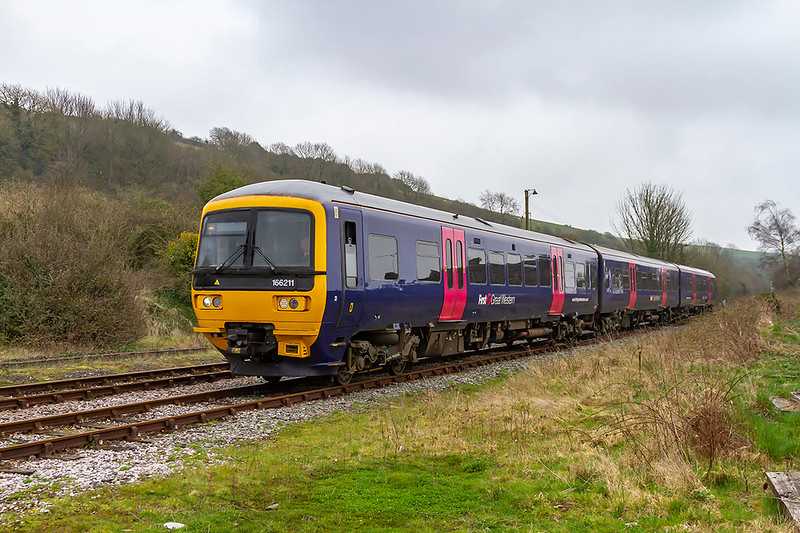 13th Apr 2018: Climbing the last few yards into the stattion at Maiden Newton is 166211  as it works 2V93 the 17.30 Weymouth to Bristol Temple Meads