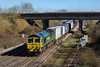 5th Apr 2018:  Runnung under the northen bye pass road bridge at Didcot North Junction is 66552 is on the point of 4O18 from Lawley Street to Southampton Maritme