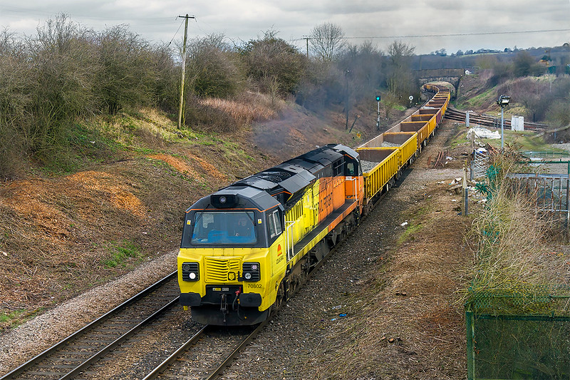 1sr Apr 2018:  Crossing Hawkeridge Junction is 70802 bringing 6C25 the the empty ballast JNAs from Filton Abbey Wood to Westbury