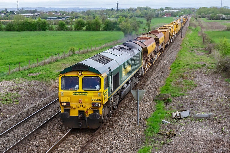 29th Apr 2018:  66526  runs through Heywood with a motly collection of track working wagons in tow and with 66543 on the rear works 6X04  from Kennington to Fairwater Yard.