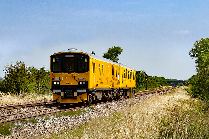 6th Aug 2018:  The Network Rail 2 car Sprinter 950001 is travelling from Derby as 2Q08.  It is captured as it runs away from Fairwood Junction and is making for Plymouth Laira