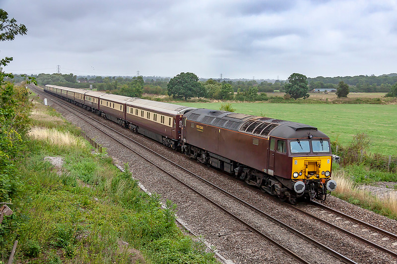 12th Aug 2018:  With drizzle in the air the Northern Belle runs towards Hawkeridge Junction with 57314 providing the urge.  1Z36 is running from Swindon to Paddington via Newbury.  The train had started from Paddington as 1Z35 and after it gets to Paddington it will work to Carnforth as 5Z36 with 47832 doing the honours.
