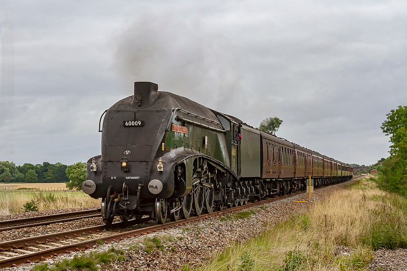 18th August 2018:  LNER A4 Pacific 60009 'Union of South Africa' is working the West Somerset Steam Express from Paddington to Minehead,  Captured here as it passes Masters Crossing at the end of the site of the long removed Fairwood Water Troughs