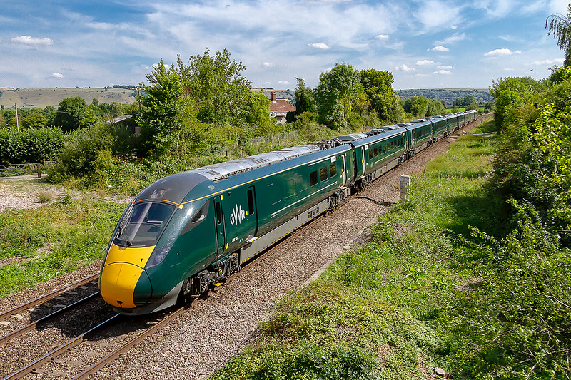 4th Aug 2018:  Using an 800/3 on a weekend Paignton service from Paddington is running for the 2nd time.  The return working is 1A84 starting from Paignton at 13.08 and due to the B & H being closed for electrification works has to run via Swindon.  800307 is snapped shortly after is lhas left Westbury and runs through Heywood