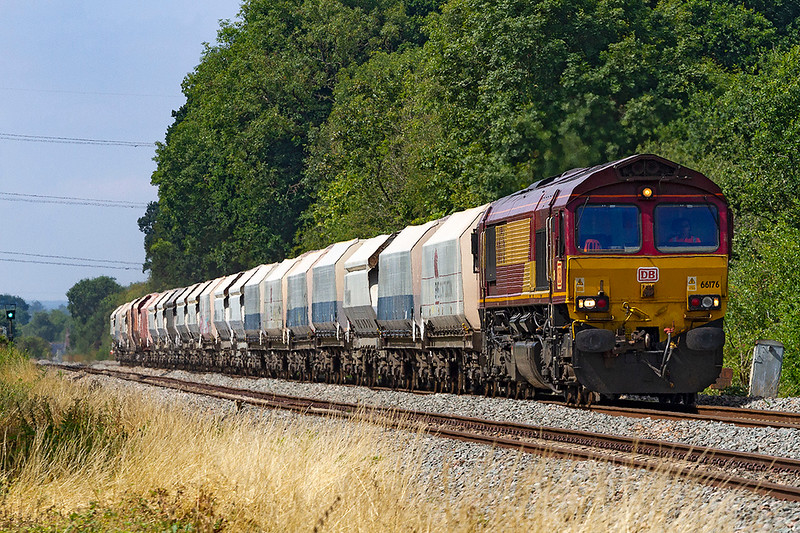 6th Aug 2018:  66176 in charge of 6M20 to St Pancras Churchyard Siding from Whatley Quarry is nearing Fairwood Junction