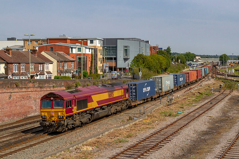 7th Aug 2018:   DB stickered 66105 powering '4O43' the 03:59 from Wakefield-Europort  to Southampton Western Docks-Berth 109 is pictured from the Campbell Road bridge in Eastleigh.