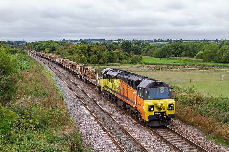 19th Aug 2018:  6C97 is running from Exeter Cowley Junction to Westbury with a LWR train powered T n T by 70802 and 70804 is captured as it runs through Fairwood