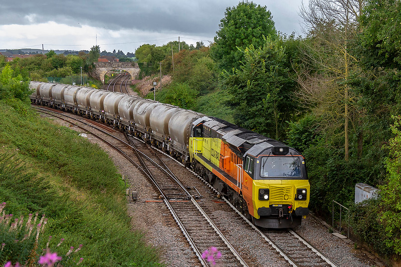 24th Aug 2018:   Coming off the 1942 built east chord at Hawkeridge Junction in Westbury is 70815 as it works 6C36 from Westbury to Aberthaw.  The PCAs are being returned to the Cement Works in South Wales for a refill that will be taken to Moorswater in Cornwall