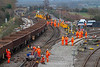 24th Dec 2018:  With the crane is now away to collect some more track in the foreground are a team cutting the track into sections.