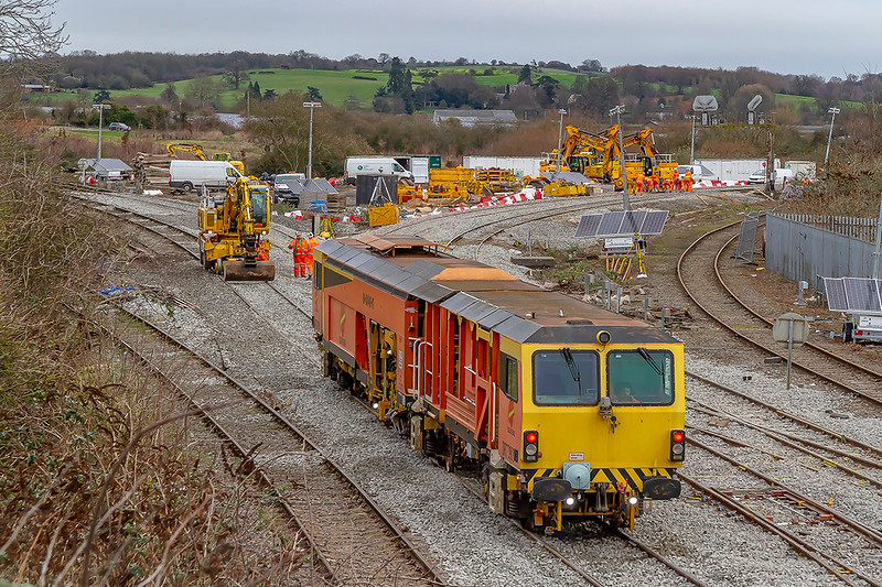 30th Dec 2018:  Plasser Theurer Switch and Crossing Tamper DR73908  stands waiting.  The mobile shovels in the compound are in the process of being taken away by road.
