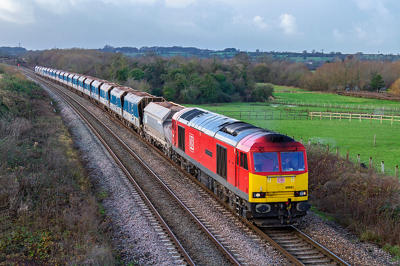 7th Dec 2018:  Tug 62 'Stainless Pioneer' is between Fairwood Junction and Westbury as it provides the grunt on 7B12 from Merehead to Wootton Bassett.  Well actually is was only doing about 2mph as the next signal, about 40 yards away, was at red so grunt was not required at this moment.