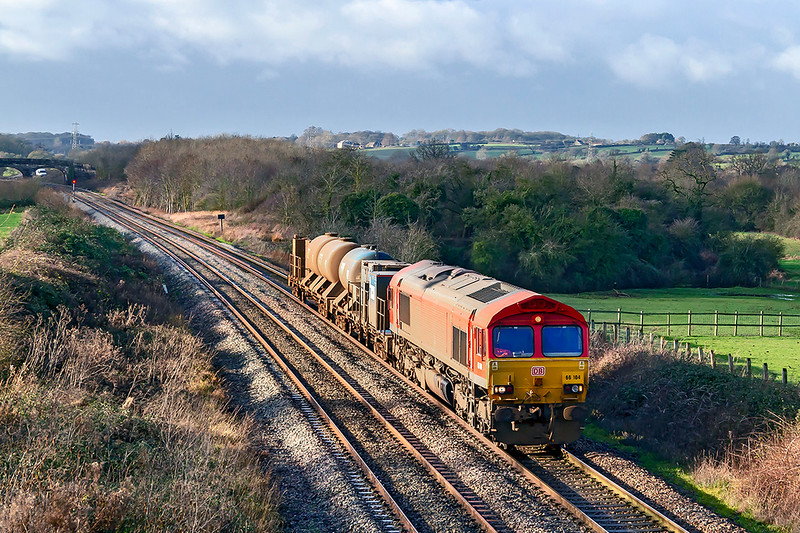 20th Dec 2018:  66104 is on the point of 6Z06 from Exeter Riverside to Westbury at fairwood. The load is the now very dirty Rail Head Treatment Train set that was based at St Blazey.  Now that the season has ended it will probably have to be moved up north  to the base in the morning