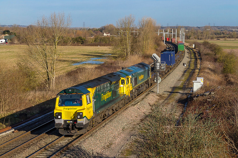 12th Feb 2018:  70017 & 66562 are working 4O21 from Crewe Basford Hall to Southampton Maritime Container Terminal at Didcot North Junction. Due to the electrification project being vastleu over budget putting the wires up to Oxford has been shelved for the time being.  So the distant posts will remain unused and this shaot will remain.