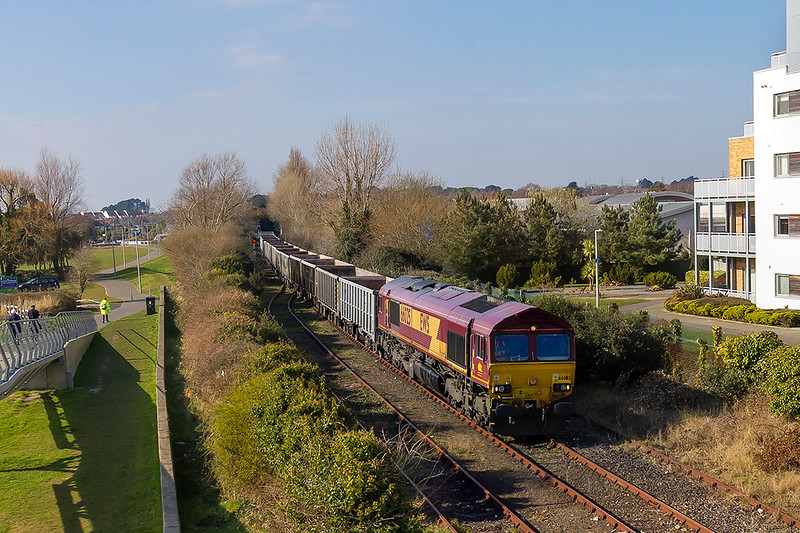 23rd Feb 2018:  66023 trundles towards the end of the Hamworthy Branch where it will run round the train and then work it as 6V52 back to Whatley Quarry