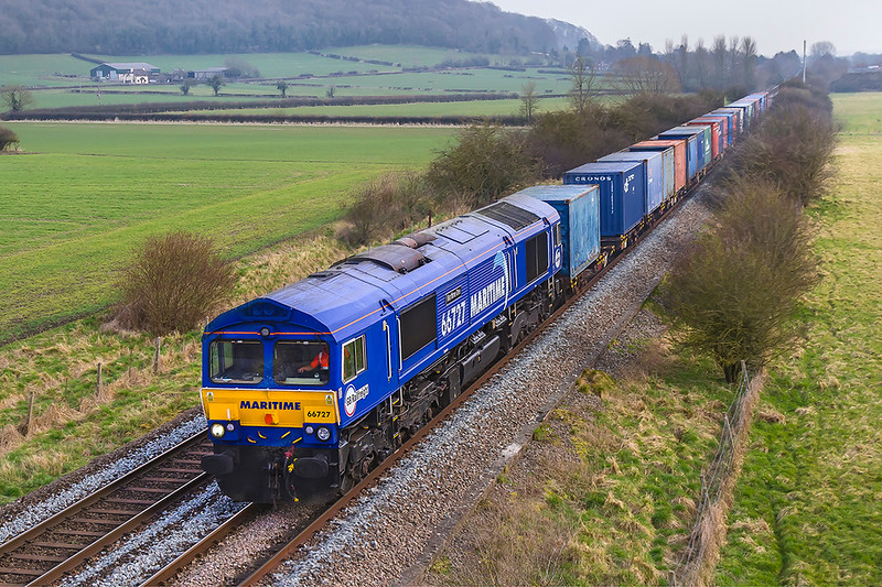 22nd Feb 2018:  The Marchwood to Biscester MOD servive runs for thr 2nd time in the week and is again powered by 66727.  6M46 is captured from the bridge on the Warminster By-Pass thet is known locally as Granada Bridge